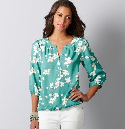 Floral blouse with white pants