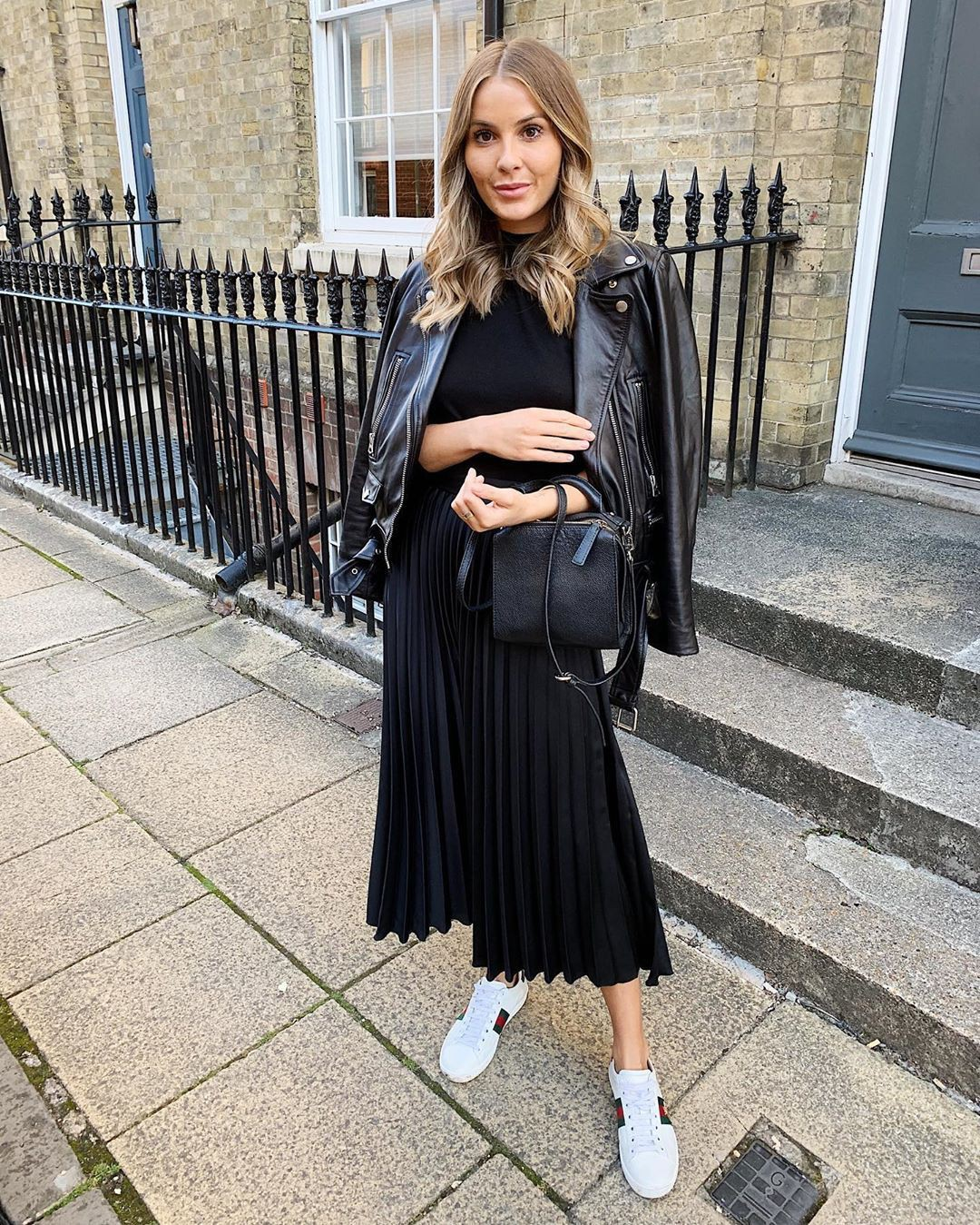 Black pleated skirt outfit, leather jacket, street fashion, crop top