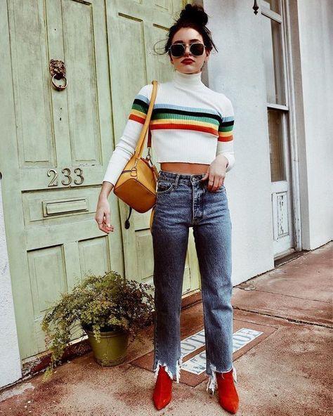 Look com bota vermelha e calça jeans