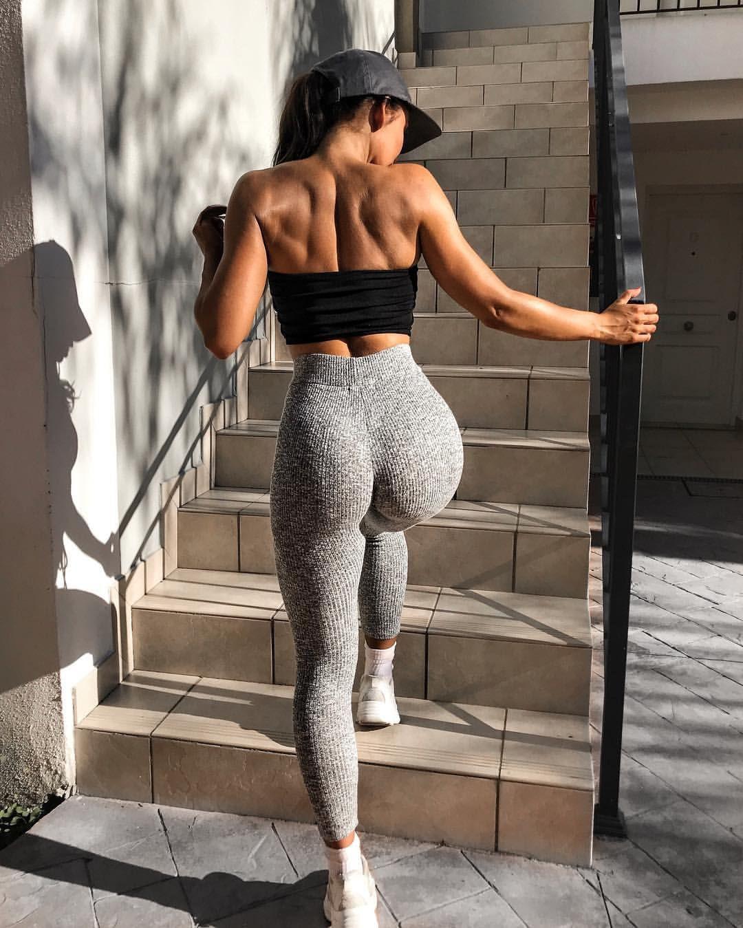 Girl wearing nothing but yoga pants