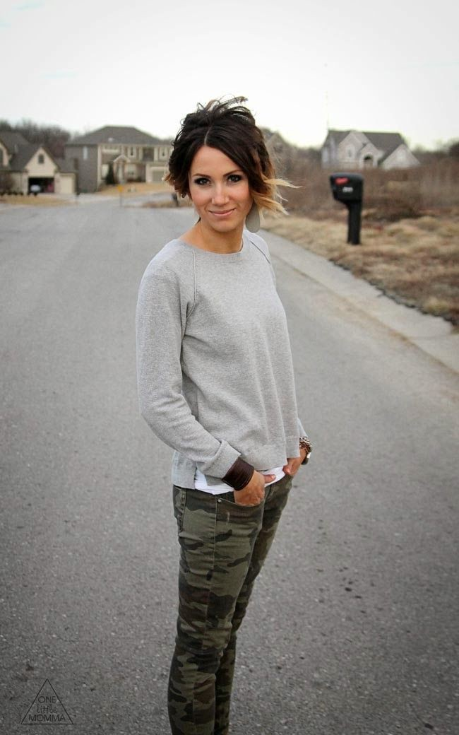 Camo pants and a grey sweater