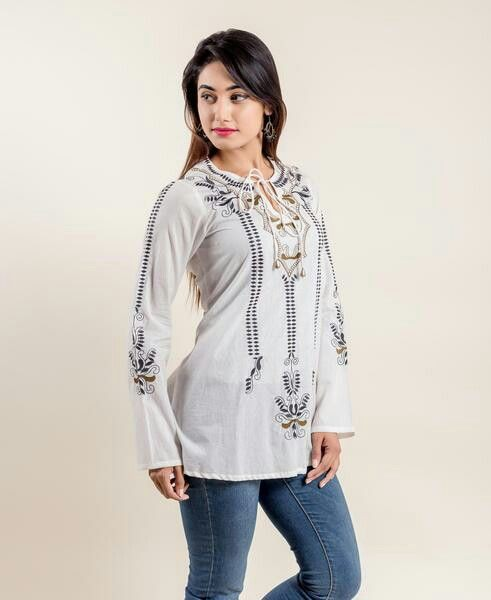 Beige and white fashion collection with formal wear, embroidery, trousers