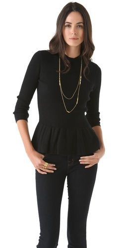 Black colour outfit with sweater, blouse, top