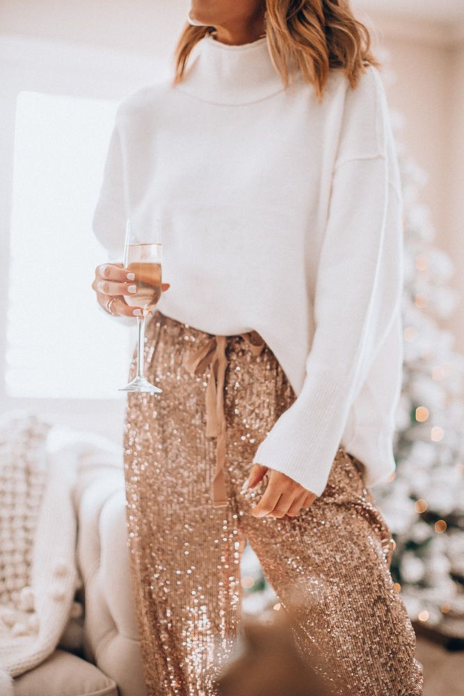 White outfit style with trousers, sweater, skirt