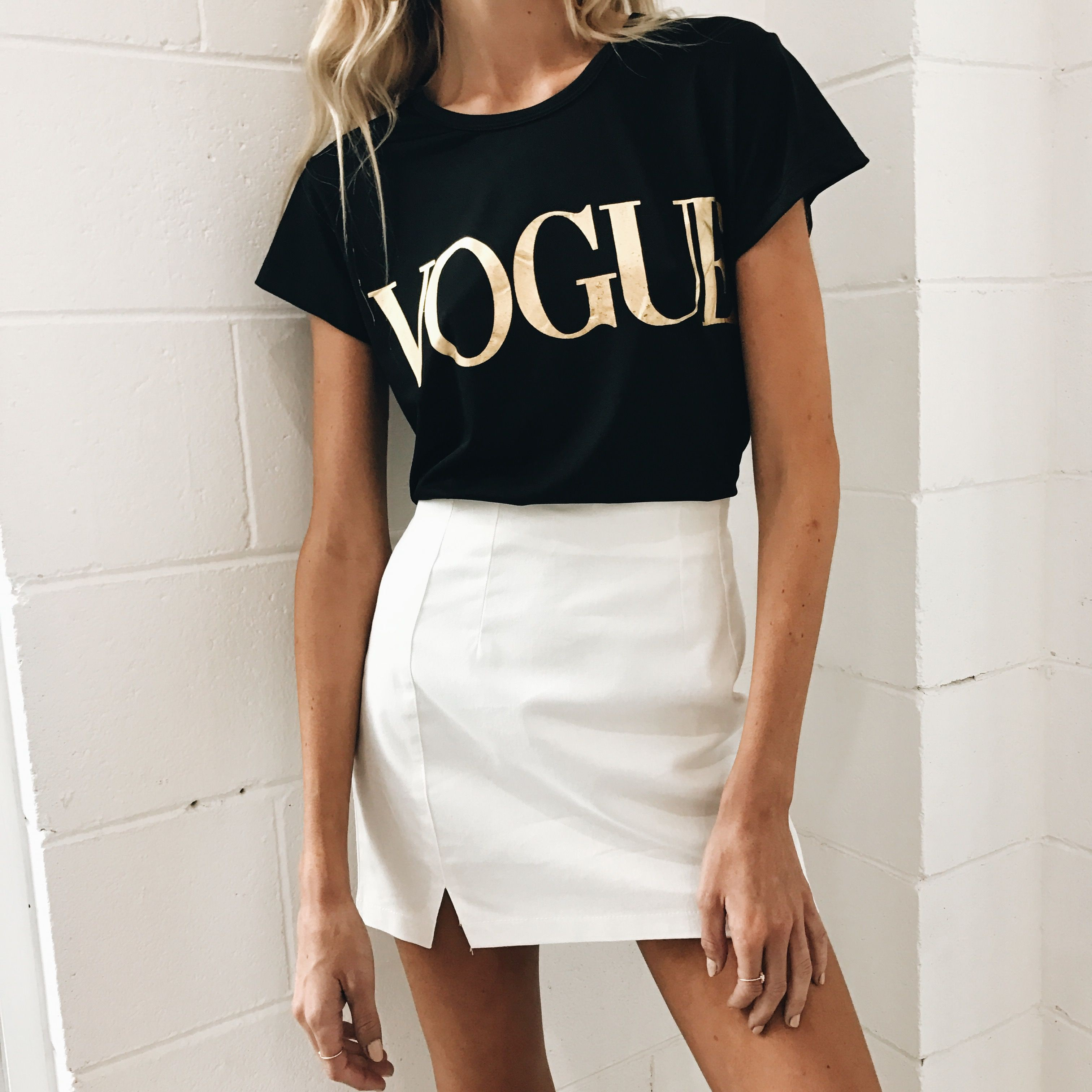 Black and white colour outfit with miniskirt, trousers, crop top
