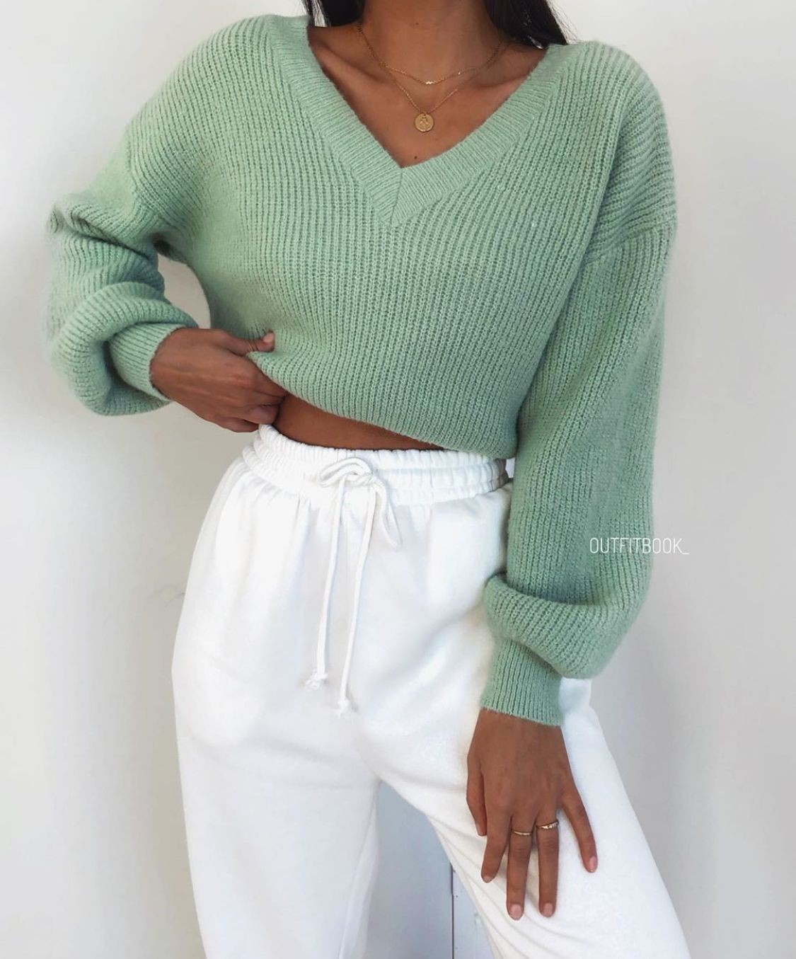 Turquoise and green outfit style with sweater