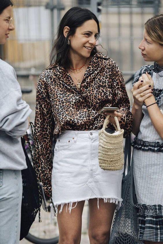 Animal print street style, fashion accessory, street fashion, animal print, denim skirt, brown h ...