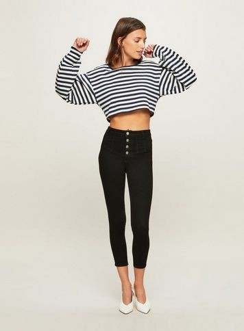 Black and white outfit style with leggings, crop top, jeans
