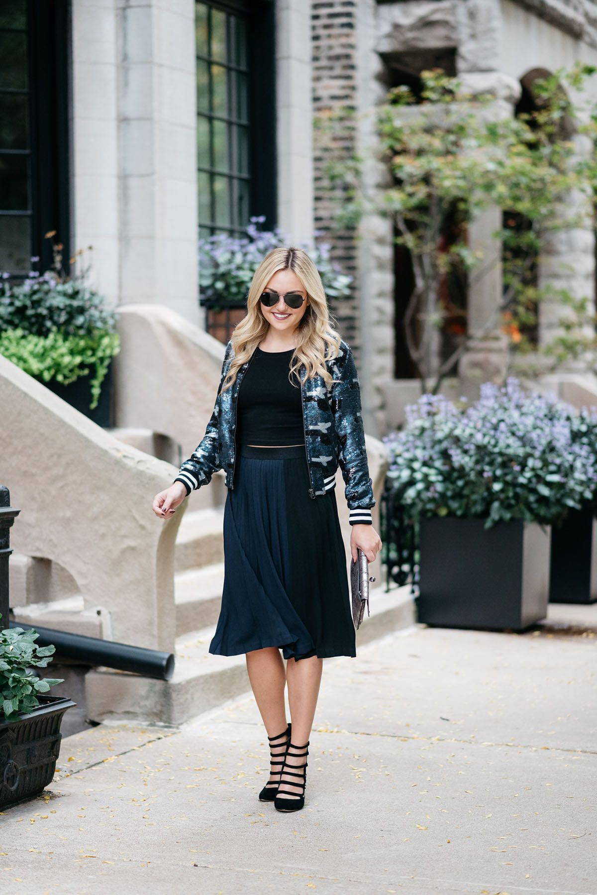 Bomber jacket and pleated skirt
