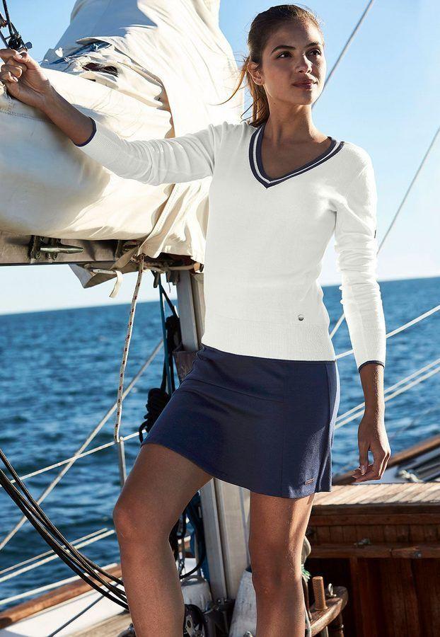 White attire ideas with sweater, blazer, shorts