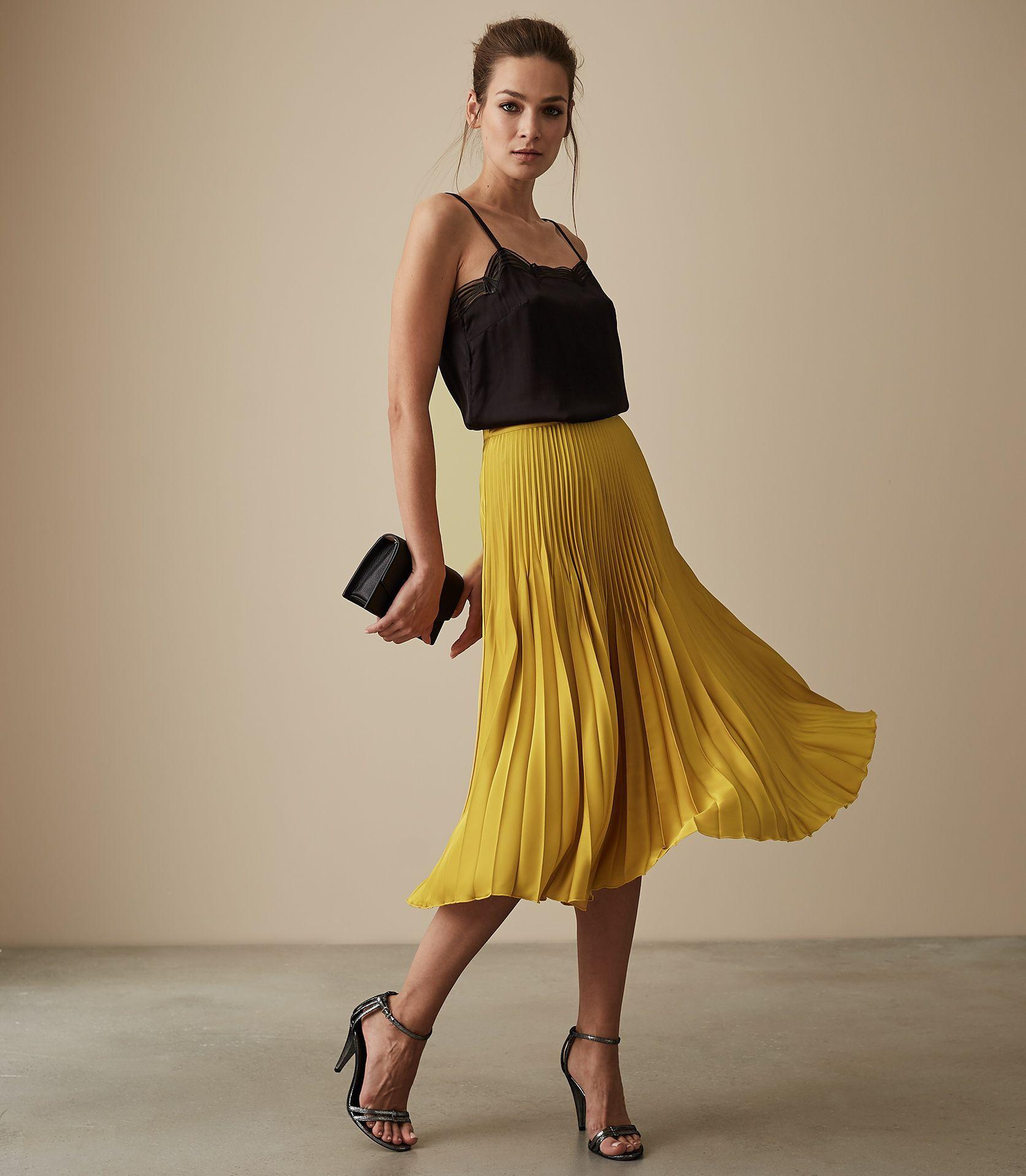 Black top yellow skirt dress