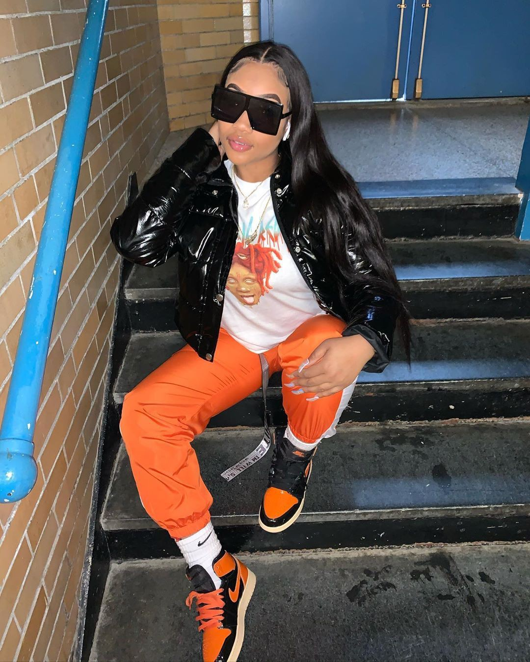 Orange colour outfit with sportswear, trousers, jacket